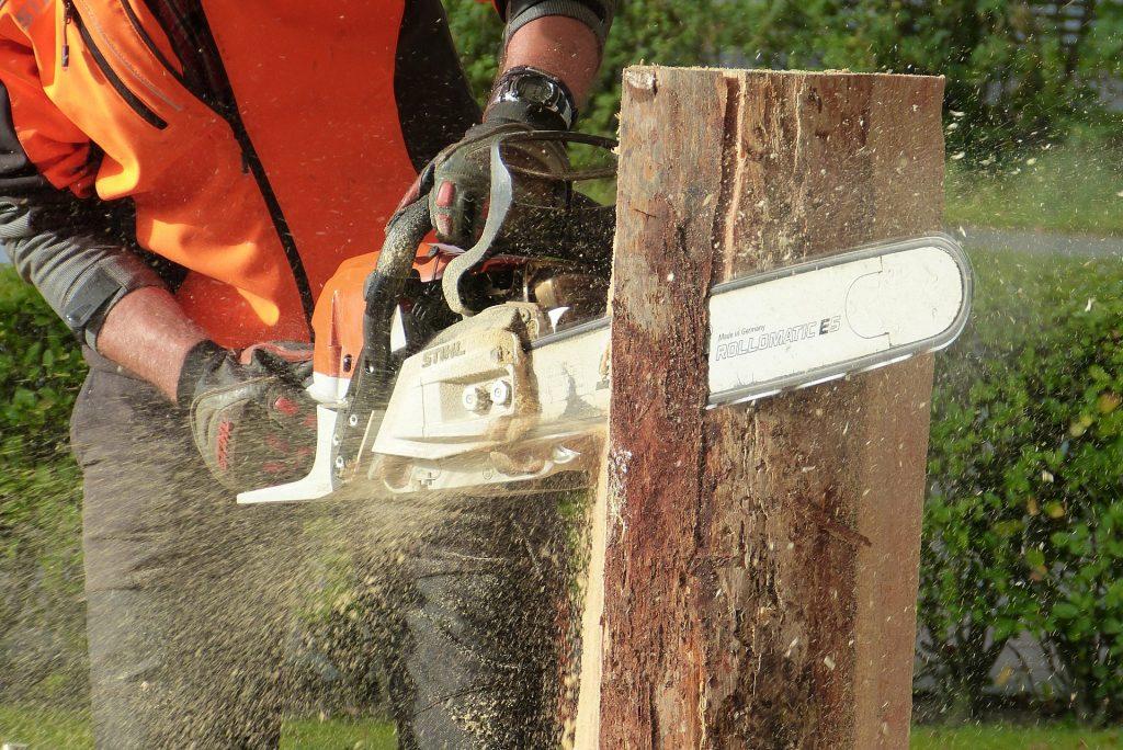 Chainsaw cutting into a log